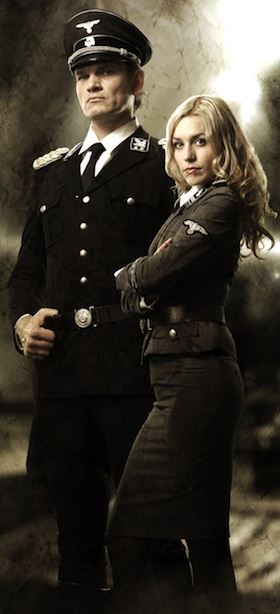 Götz Otto & Julia Dietze as Klaus Adler & Renate Richter in Iron Sky